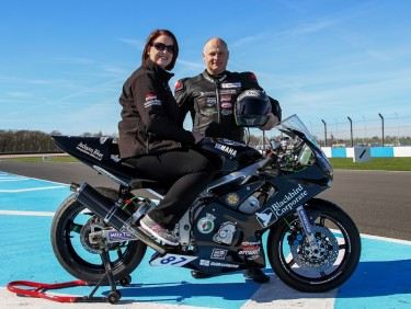 Lisa Foster with one of the racers she sponsors